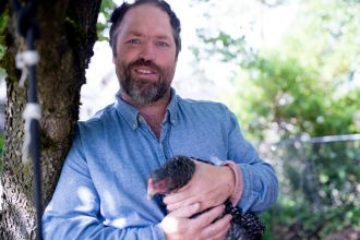 Dan Campbell holding on to one of his chickens