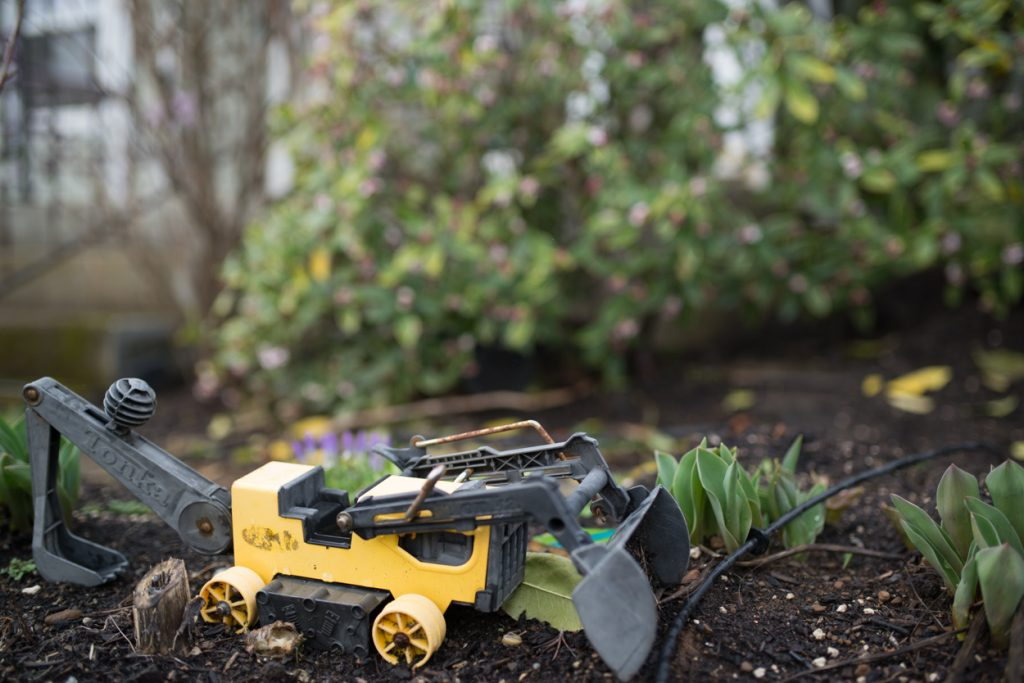 Toy tonka tractor and flower garden