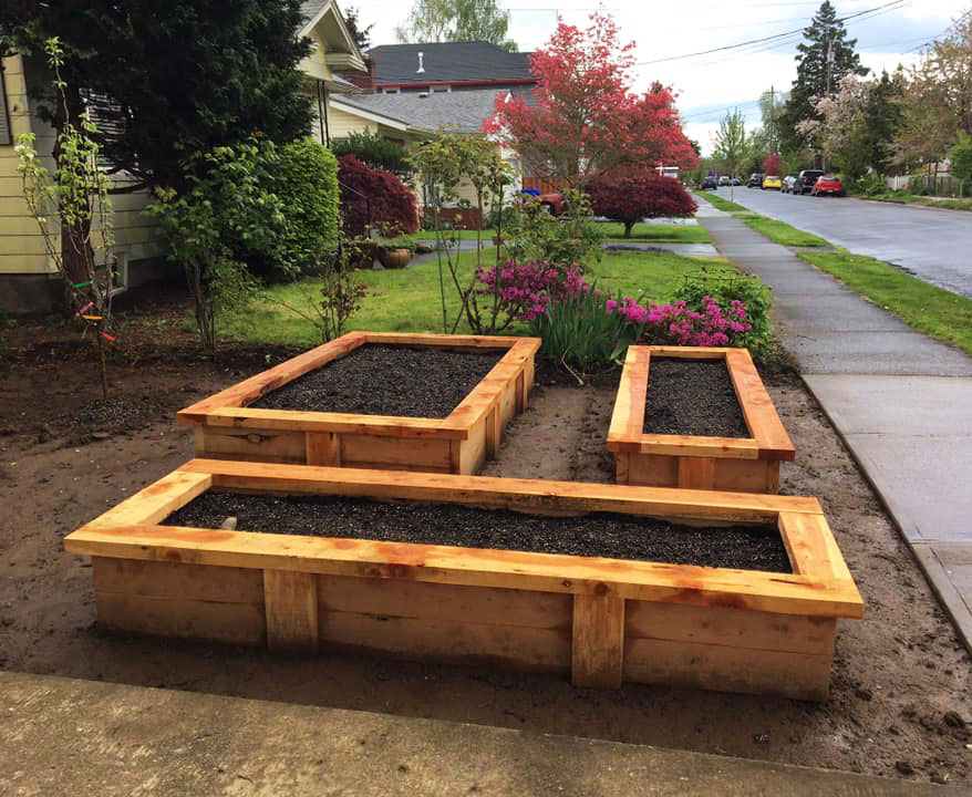 three pdxfarm raised beds in a front ganden